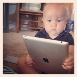 Baby with an iPad