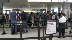 TSA Checkpoint - Road Warriors know to avoid this by being a part of TSA's Pre-Check