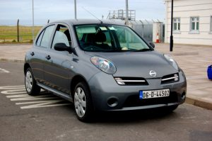 A rented Nissan Micra in Donegal, Ireland. Beware the business travel myths about rental cars!