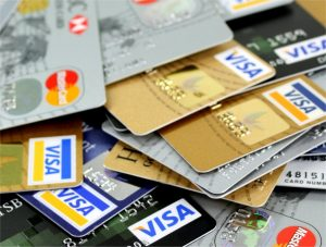 A messy stack of credit cards - Churning credit cards can damage your credit