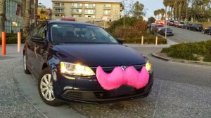 The instantly recognizable pink mustache of a Lyft car. It's becoming a favorite method of travel among business travelers.