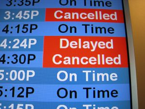 Photo of a flight departure screen showing a delayed flight. Google Flights can more easily predict these now.