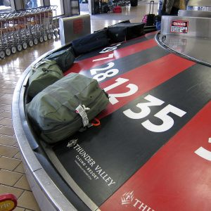 Baggage claim, where people waste time if they check bags.
