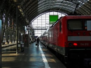 A train in a station. A travel writer suggested riding trains overnight to save money and time.