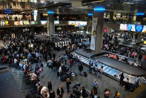 A crowded baggage claim area at Las Vegas airport. If you travel light this holiday, you can avoid scenes like this.