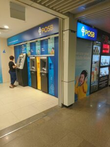 ATMs at Bugis MRT Station in Singapore. ATMs can help you protect your money during international travel.