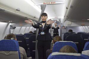 Flight attendants giving a flight safety demonstration.