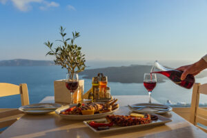 You can relive your traveling experiences and still travel the world by recreating your favorite dishes. This is a dinner for two by the sea.
