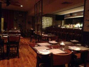 Photo of an empty restaurant. One of our travel predictions is that people will begin to flock to restaurants.