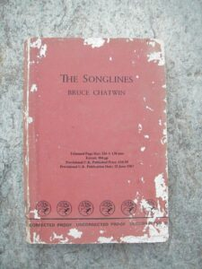 "A copy of Bruce Chatwin's ""The Songlines,"" one of our recommended travel books."