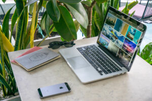 A laptop, nomad, and mobile phone are all part of the digital nomad life.