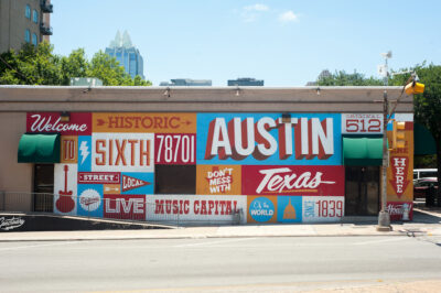 Mural on the side of a building touting Austin, Texas' features. Austin, Texas is a great place for a family-friendly vacation, especially if you like live music.