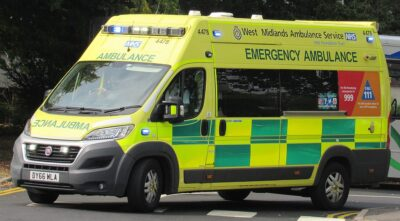 An ambulance from the West Midlands. Your travel insurance may not cover illness in other countries.