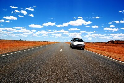 A single car in the Australian outback. It's a metaphor for the car rental shortage.