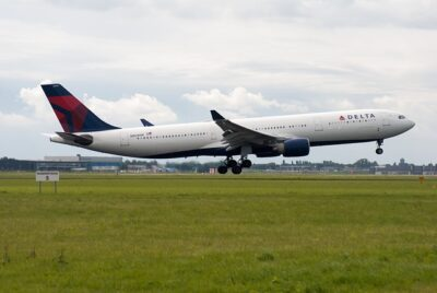 Photo of a Delta Airlines plane starting to take off.